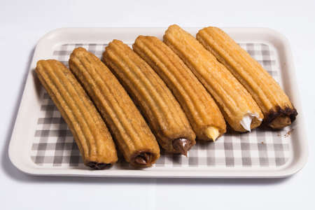 Churros with different tastes on a white background