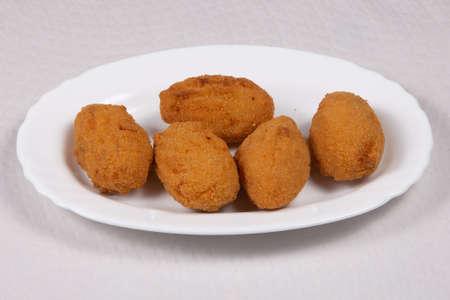 Potato croquettes croquetas in a white plate. Fast Food