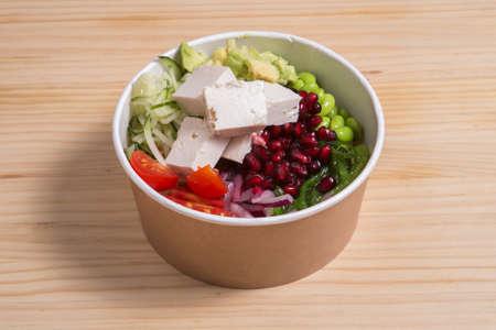 Poke with avocado, cheese feta, pomegranae and beans 版權商用圖片