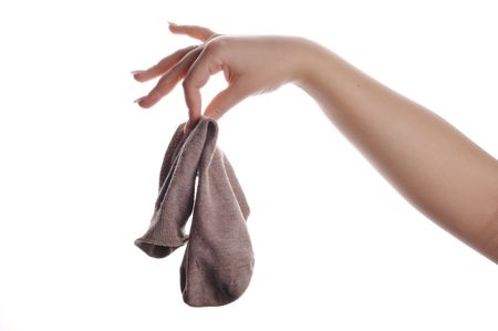 slob: dirty sock in hand isolated on white Stock Photo