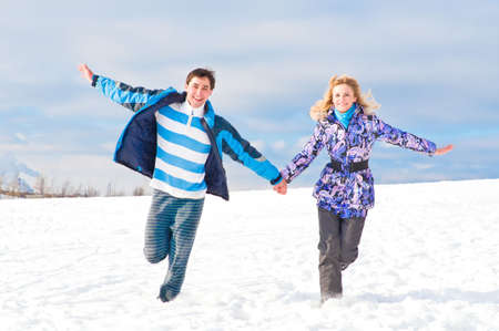undertaken: Young guy and the girl walk together in the winter