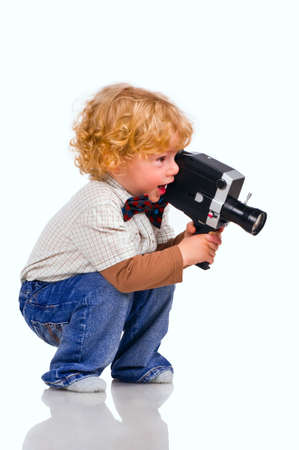 hair roller: The little boy with an old videocamera in hands