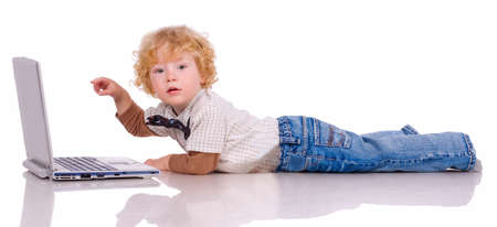 payload: The little boy with curly hair holds in hands notebook Stock Photo