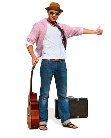 voted: Young, stylish guy with a guitar voted to catch a ride  Isolated on white background