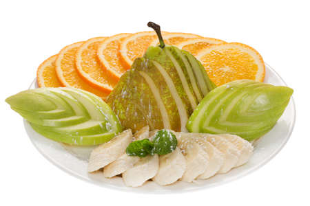 fruit plate: Fruit plate with oranges, apples, pears, bananas and mint leaf, sprinkle with powdered sugar. All sliced. White plate on a white background