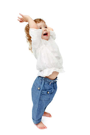 hands lifted up: The child dances on a white background, lifted his leg, walks, indulge in, runs, plays, hands up