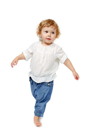 indulge: The child dances on a white background, lifted his leg, walks, indulge in, runs