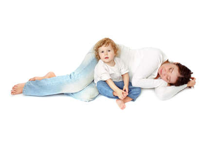 fond of children: Grandma lies stayed with her granddaughter. Awake baby sitting around sleeping mom, white background