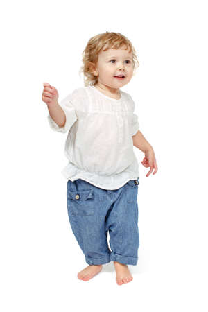 indulge: The child dances on a white background, smile, walks, indulge in, runs