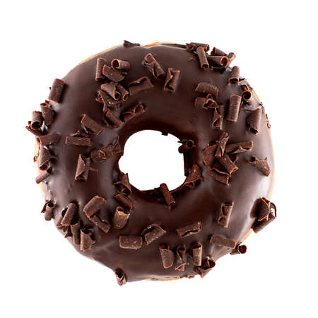 A single chocolate glazed donut with chocolate chips isolated white background 免版税图像