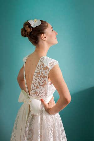 Young bride in wedding dress smug satisfied and happy
