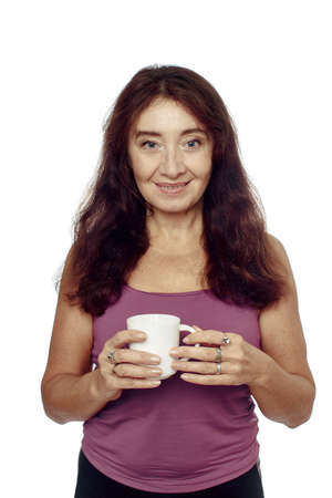 ring finger: Middle-aged Woman, involved in sports, holding a cup in hand, on the ring finger on a white background Stock Photo