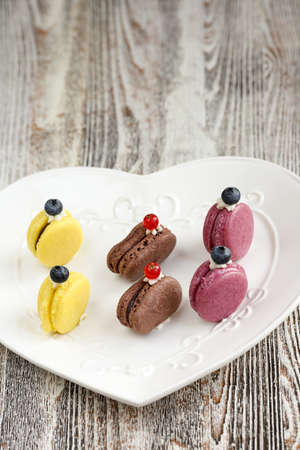 truly: Cookies and cream Macaron. French meringues are truly Hard To Resist Delicacies. Variety of flavors. Sandwich-like cookies, made with eggs whites, sugar and ground almonds