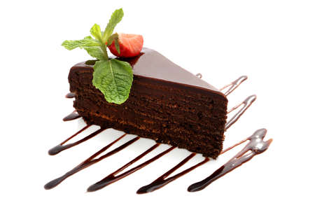 Chocolate sacher cake with strawberries, mint and chocolate sauce close-up isolated on white