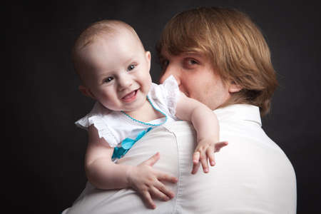 0 3 months: Portrait of a father and his newborn baby daughter on a black background Stock Photo