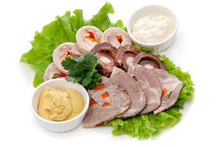 mustard leaf: Cutting meat rolls on lettuce leaf with parsley and sauces: mustard and horseradish Isolated on white background