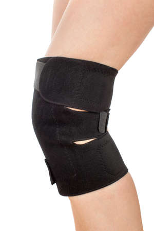 kneecap: Closeup of woman leg with knee braces isolated on white