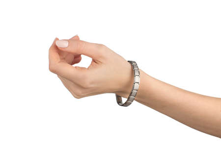 Women left hand healing tourmaline magnetic bracelet on a white background, isolate 스톡 콘텐츠