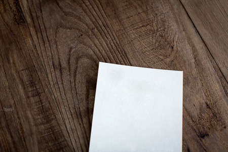 business letter: A piece of white paper on the wooden table Stock Photo