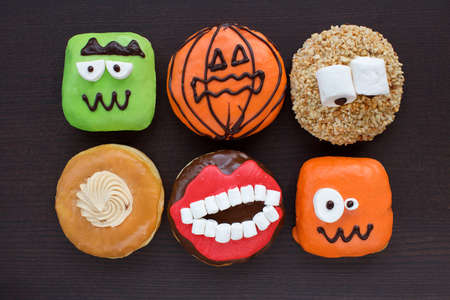 Set of cakes donut for the holiday halloween. Donuts on darck wooden background Stock Photo