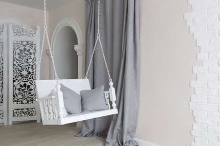 cushions: minimalist interior design with pretty white swing with cushions