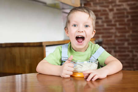 Five years boy opened his mouth porridge kitchen