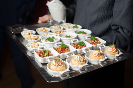 A waiter with a tray of snacks at a banquet Stock Photo