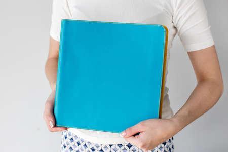 Female holding blue paper folder Reklamní fotografie
