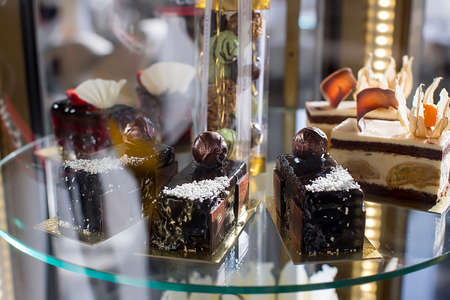Various desserts on glass showcase
