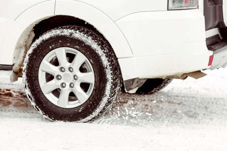 no skid: The wheel from the car on a winter road close up Stock Photo