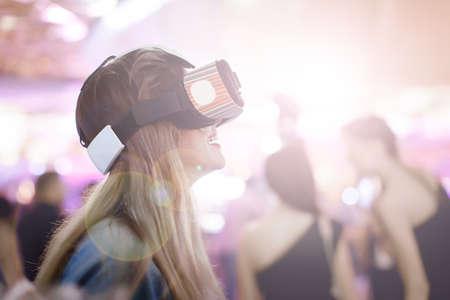 Female wearing virtual reality glasses Stock Photo