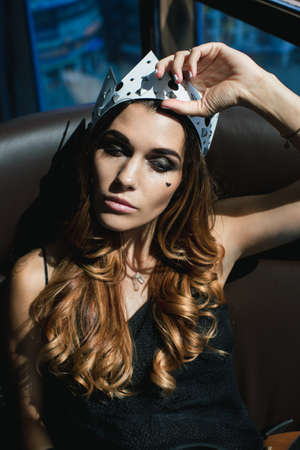 Young woman in a crown