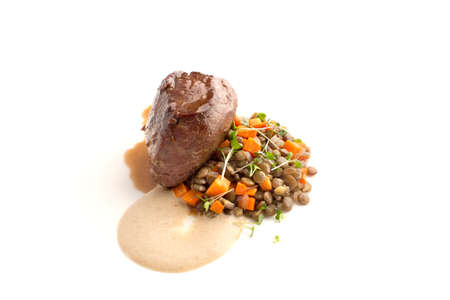 Fillet mignon with lentil and sauce isolate Stock Photo