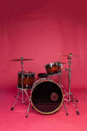 Drum set on a red studio background