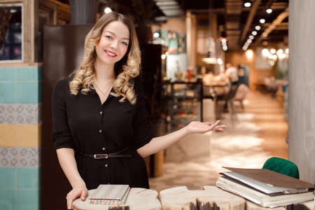 The benevolent administrator invites you to visit a good cafe Stock Photo