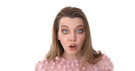 Female Face in Shock, Close Up. Portrait young surprised and shockedwoman in pink. Amazed by Surprise, Excited Brunette Woman, White Background
