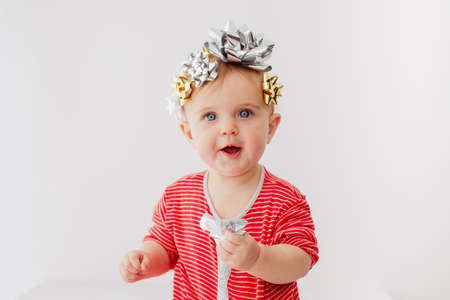 Baby decorated with a bow as a gift on a white background