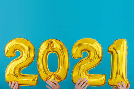 Gold foil number two thousand and twenty one 2021 celebration balloon on blue background