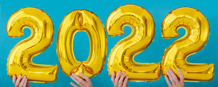 Gold foil number two thousand and twenty two 2022 celebration balloon on blue background 写真素材