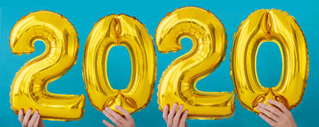 Gold foil number two thousand and twenty 2020 celebration balloon on blue background