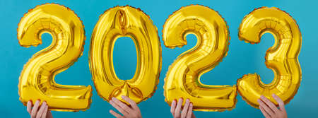 Gold foil number two thousand and twenty three 2023 celebration balloon on blue background