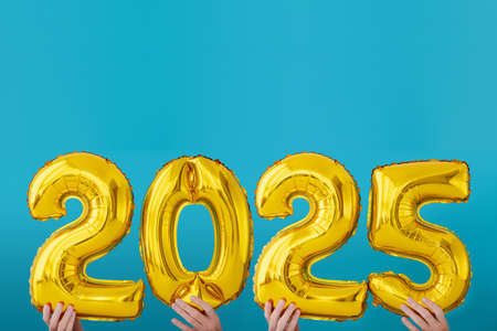 Gold foil number two thousand and twenty five 2025 celebration balloon on blue background