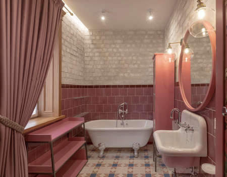 Bath sink and large mirror on brick wall in fashionable bathroom with modern lightening Stockfoto