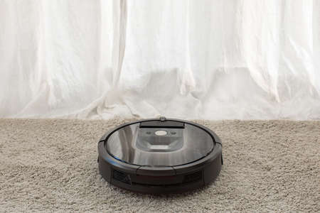 Sets the program to the robot vacuum cleaner Banque d'images