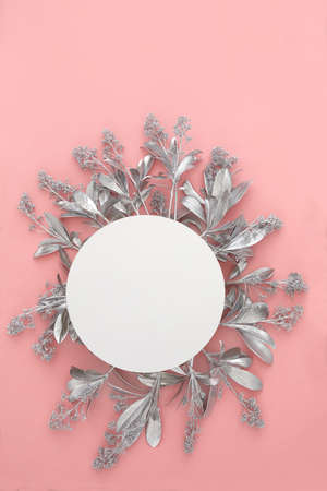 Blank paper card mockup with silver flowers. Holiday concept with place for text on a pink pastel background