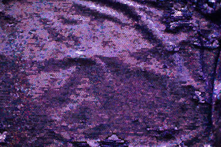 fabric texture of purple sequins with hologram liter. Hologram Foil Aesthetic. Trendy vaporwave shiny gradient