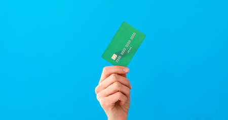 Hand holding credit cards and showing it