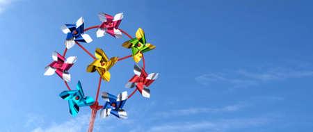 Pinwheel swirling wind on blue sky background