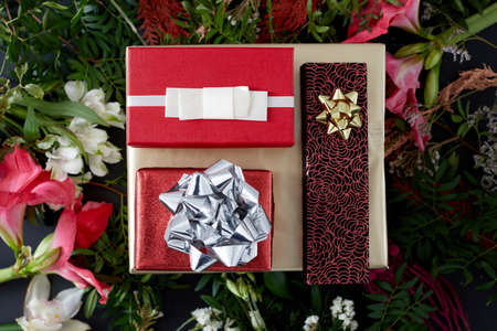 Set of red gift boxes and flowers