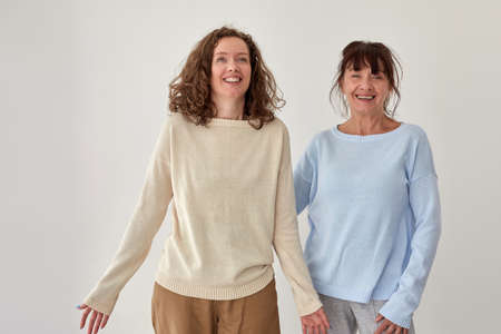 Positive mature mother and adult daughter in studio Stockfoto